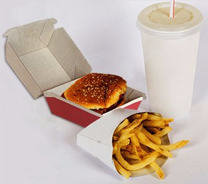 Image of fast-food meal: fries in container, burger in box, and disposable, soft drink container.