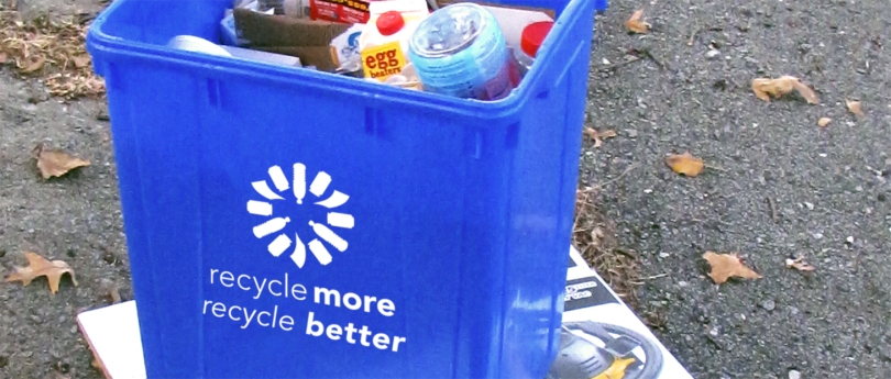 "Image of full curbside recycling bin on a curb, with Recycle More Recycle Better logo. Text reads: ""recycle more, recycle better""."
